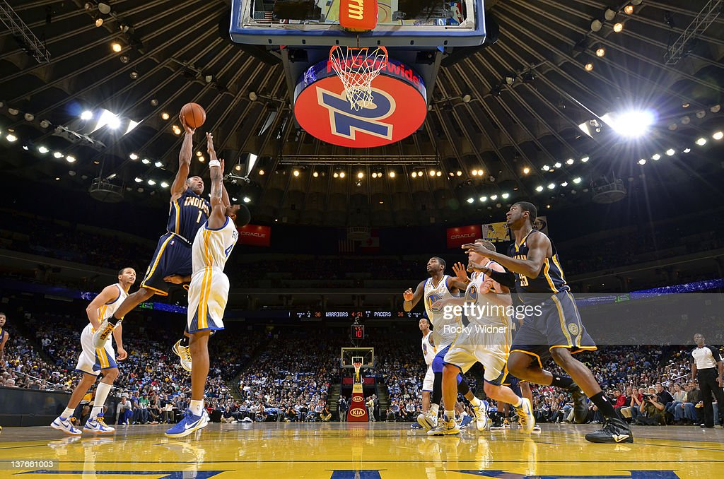 <a gi-track='captionPersonalityLinkClicked' href=/galleries/search?phrase=Dahntay+Jones&family=editorial&specificpeople=202206 ng-click='$event.stopPropagation()'>Dahntay Jones</a> #1 of the Indiana Pacers drives the ball against <a gi-track='captionPersonalityLinkClicked' href=/galleries/search?phrase=Brandon+Rush+-+Basketball+Player&family=editorial&specificpeople=802089 ng-click='$event.stopPropagation()'>Brandon Rush</a> #4 of the Golden State Warriors on January 20, 2012 at Oracle Arena in Oakland, California.