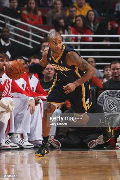 Dahntay Jones of the Indiana Pacers drives the ball upcourt against the Chicago Bulls during the game on December 29 2009 at the United Center in...