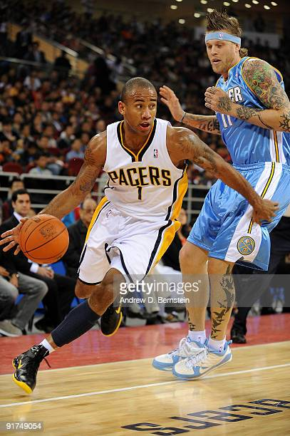 Dahntay Jones of the Indiana Pacers drives to the basket against Chris Andersen of the Denver Nuggets during the game on October 11 2009 at the...