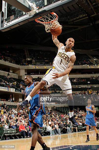 Dahntay Jones of the Indiana Pacers jams over a Oklahoma City Thunder defender at Conseco Fieldhouse on March 21 2010 in Indianapolis Indiana The...