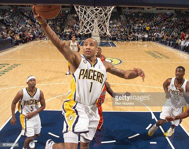 Dahntay Jones of the Indiana Pacers lays the ball up against the Golden State Warriors at Conseco Fieldhouse on November 11 2009 in Indianapolis...