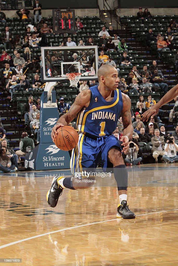 <a gi-track='captionPersonalityLinkClicked' href=/galleries/search?phrase=Dahntay+Jones&family=editorial&specificpeople=202206 ng-click='$event.stopPropagation()'>Dahntay Jones</a> #1 of the Indiana Pacers moves the ball against the Charlotte Bobcats on February 19, 2012 at Bankers Life Fieldhouse in Indianapolis, Indiana.