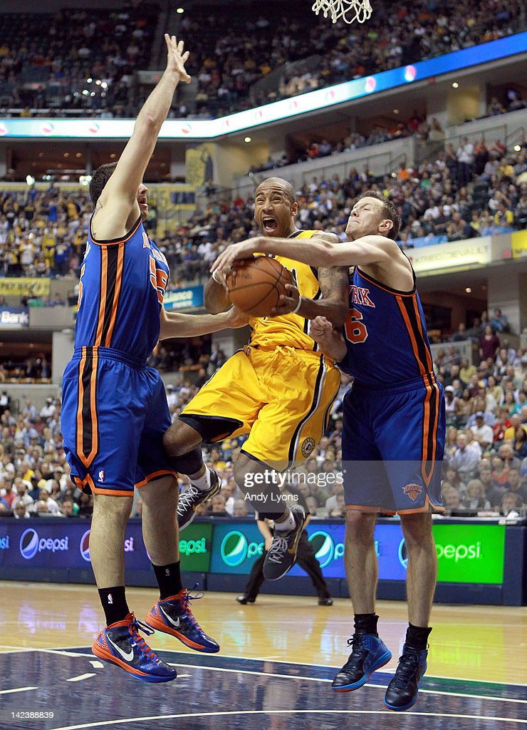 <a gi-track='captionPersonalityLinkClicked' href=/galleries/search?phrase=Dahntay+Jones&family=editorial&specificpeople=202206 ng-click='$event.stopPropagation()'>Dahntay Jones</a> #1 of the Indiana Pacers shoots the ball while defended by <a gi-track='captionPersonalityLinkClicked' href=/galleries/search?phrase=Josh+Harrellson&family=editorial&specificpeople=5590632 ng-click='$event.stopPropagation()'>Josh Harrellson</a> #55 and <a gi-track='captionPersonalityLinkClicked' href=/galleries/search?phrase=Steve+Novak&family=editorial&specificpeople=693015 ng-click='$event.stopPropagation()'>Steve Novak</a> #16 of the New York Knicks during the NBA game at Bankers Life Fieldhouse on April 3, 2012 in Indianapolis, Indiana. The Pacers won 112-104.