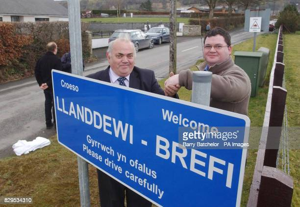 Dai Evans Chairman of Ceredigion Country Council recieves the road signs from Anthony Roberts Proprietor Zodiac Signs from Merthyr Tydfil during a...