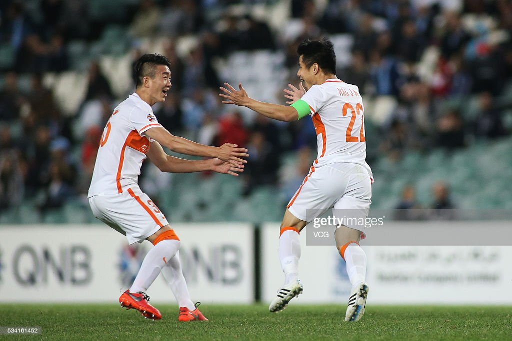 Dai Lin #35 and Hao Junmin #22 of Shandong celebrate a ball during the AFC Champions League match between Sydney and Shandong Luneng at Allianz Stadium on May 24, 2016 in Sydney, Australia.