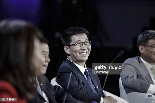 Dai Wei chief executive officer of Ofo Inc reacts during a session at the World Economic Forum Annual Meeting of the New Champions in Dalian China on...