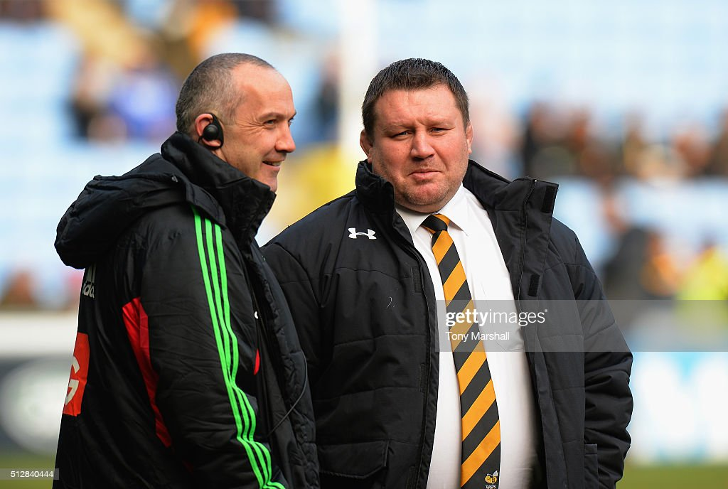 Dai Young Head Coach of Wasps talks to Conor O'Shea Head Coach of Harlequins before the Aviva Premiership match between Wasps and Harlequins at The...