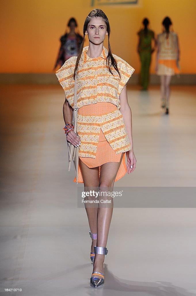 Daiane Conterato walks the runway at the Triton show during Sao Paulo Fashion Week Summer 2013/2014 on March 20, 2013 in Sao Paulo, Brazil.