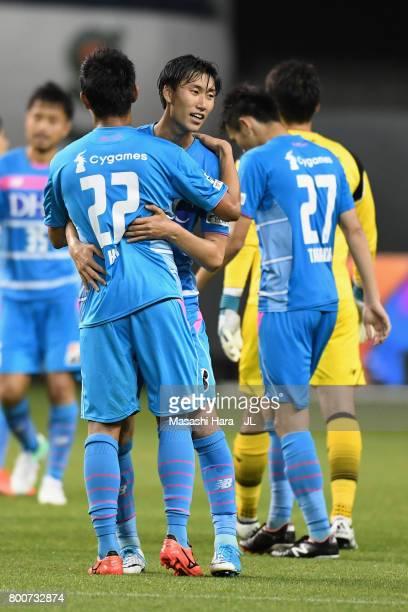 Daichi Kamada and Kei Ikeda of Sagan Tosu celebrate their 21 victory after the JLeague J1 match between Sagan Tosu and Urawa Red Diamonds at Best...