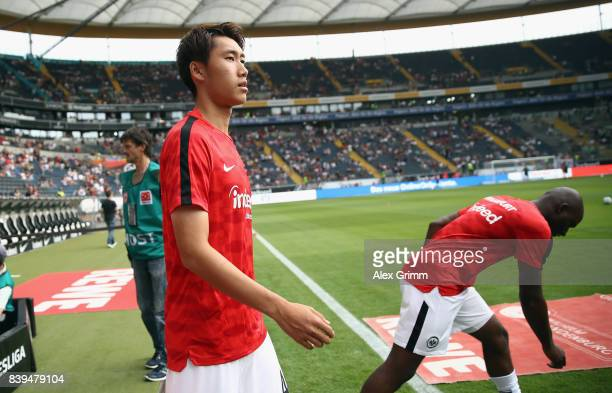 Daichi Kamada of Frankfurt comes out to the pitch to warm up for the Bundesliga match between Eintracht Frankfurt and VfL Wolfsburg at...