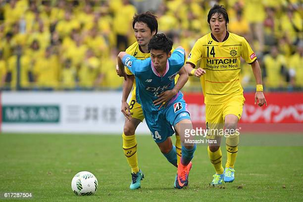 Daichi Kamada of Sagan Tosu and Akimi Barada of Kashiwa Reysol compete for the ball during the JLeague match between Kashiwa Reysol and Sagan Tosu at...