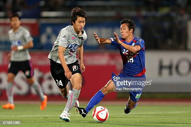 Daichi Kamada of Sagan Tosu and Hokuto Shimoda compete for the ball during the JLeague Yamazaki Nabisco Cup match between Ventforet Kofu and Sagan...