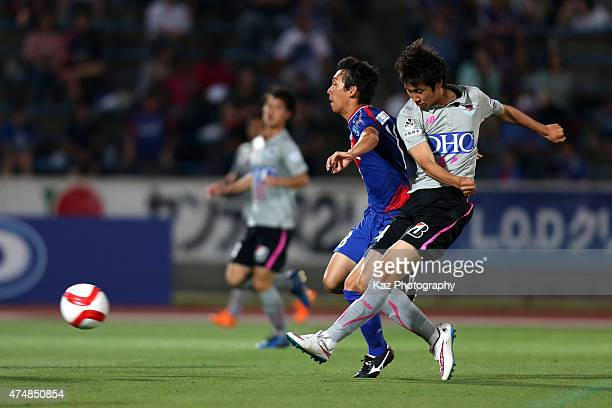 Daichi Kamada of Sagan Tosu and Hokuto Shimoda of ventforet Kofu compete for the ball during the JLeague Yamazaki Nabisco Cup match between Ventforet...