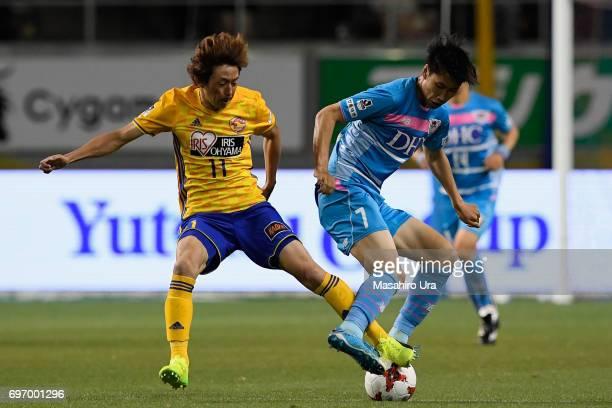 Daichi Kamada of Sagan Tosu and Naoki Ishihara of Vegalta Sendai compete for the ball during the JLeague J1 match between Sagan Tosu and Vegalta...