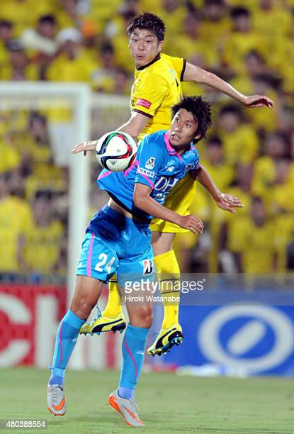 Daichi Kamada of Sagan Tosu and Naoya Kondo of Kashiwa Reysol compete for the ball during the JLeague match between Kashiwa Reysol and Sagan Tosu at...