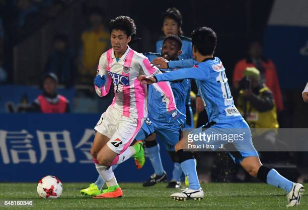 Daichi Kamada of Sagan Tosu and Ryota Oshima of Kawasaki Frontale compete for the ball during the JLeague J1 match between Kawasaki Frontale and...