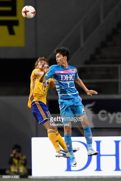 Daichi Kamada of Sagan Tosu and Yasuhiro Hiraoka of Vegalta Sendai compete for the ball during the JLeague J1 match between Sagan Tosu and Vegalta...