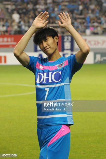 Daichi Kamada of Sagan Tosu applauds supporters after a sending off ceremony as he joins Eintracht Frankfurt after the JLeague J1 match between Sagan...