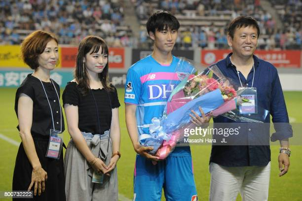 Daichi Kamada of Sagan Tosu attends a sending off ceremony with his wife and parents as he joins Eintracht Frankfurt after the JLeague J1 match...