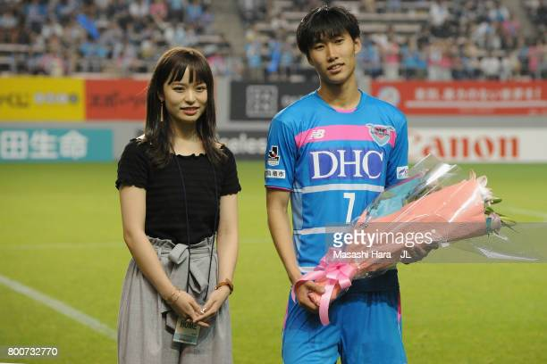 Daichi Kamada of Sagan Tosu attends a sending off ceremony with his wife as he joins Eintracht Frankfurt after the JLeague J1 match between Sagan...