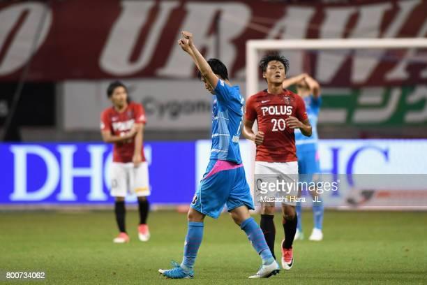 Daichi Kamada of Sagan Tosu celebrates the 21 victory after the JLeague J1 match between Sagan Tosu and Urawa Red Diamonds at Best Amenity Stadium on...