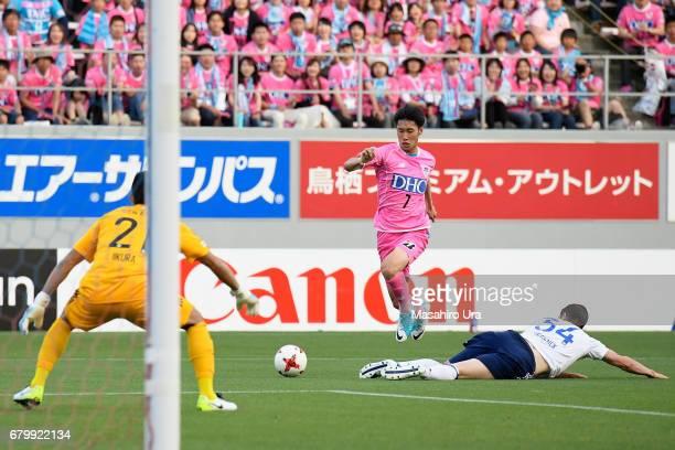 Daichi Kamada of Sagan Tosu goes past Milos Degenek of Yokohama FMarinos during the JLeague J1 match between Sagan Tosu and Yokohama FMarinos at Best...