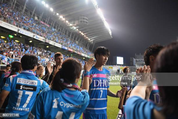 Daichi Kamada of Sagan Tosu high fives with supporters after a sending off ceremony as he joins Eintracht Frankfurt after the JLeague J1 match...