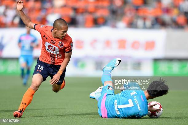 Daichi Kamada of Sagan Tosu is challenged by Ryo Okui of Omiya Ardija during the JLeague J1 match between Omiya Ardija and Sagan Tosu at NACK 5...