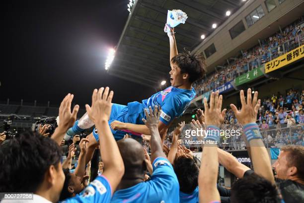 Daichi Kamada of Sagan Tosu is tossed into the air after a sending off ceremony as he joins Eintracht Frankfurt after the JLeague J1 match between...