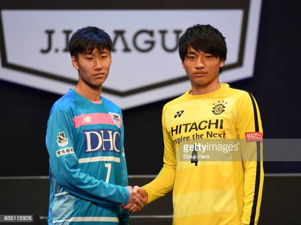 Daichi Kamada#7 of Sangan Tosu shakes hands with Shinnosuke Nakatani#4 of Kashiwa Reysol during the JLeague Kick Off Conference at Tokyo...