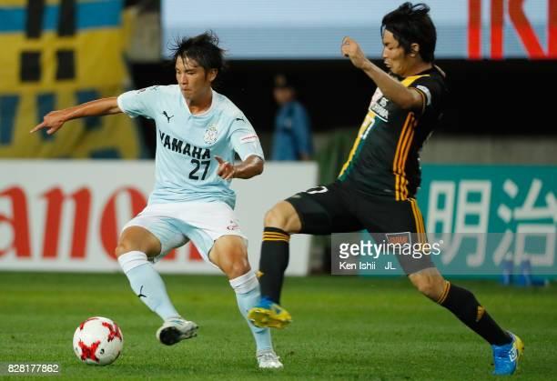 Daigo Araki of Jubilo Iwata and Kazuki Oiwa of Vegalta Sendai compete for the ball during the JLeague J1 match between Vegalta Sendai and Jubilo...