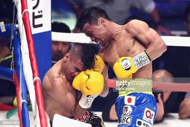 Daigo Higa of of Japan punches Juan Hernandez Navarrete of Mexico during the WBC World Flyweight title bout between Juan Hernandez Navarrete and...