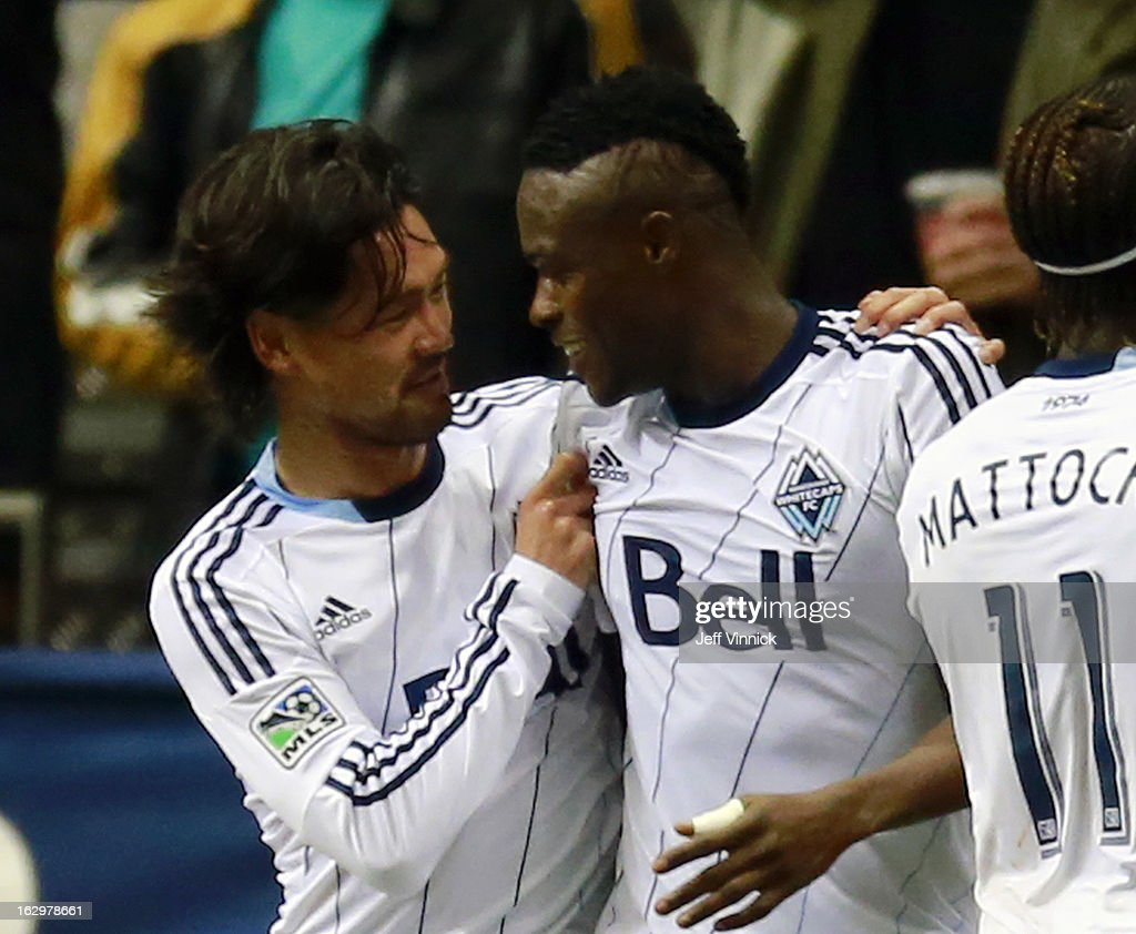 Daigo Kobayashi #14 congratulates Gershon Koffie #28 of the Vancouver Whitecaps FC who scored against the Toronto FC during their MLS game at BC Place March 2, 2013 in Vancouver, British Columbia, Canada.