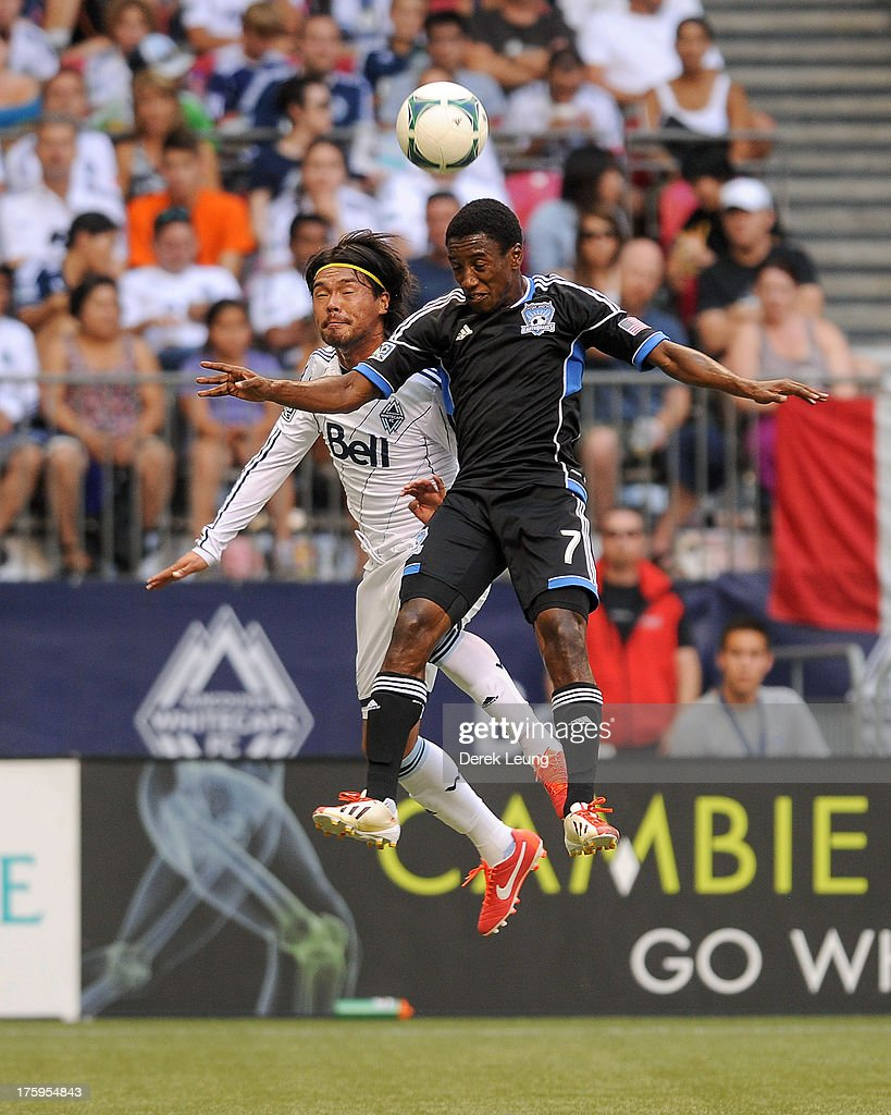 Daigo Kobayashi of the Vancouver Whitecaps jumps for a header against Cordell Cato of the San Jose Earthquakes during an MLS match at BC Place on...