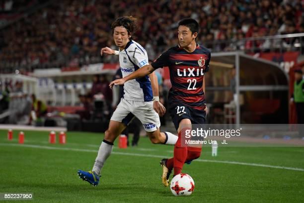 Daigo Nishi of Kashima Antlers and Hiroki Fujiharu of Gamba Osaka during the JLeague J1 match between Kashima Antlers and Gamba Osaka at Kashima...