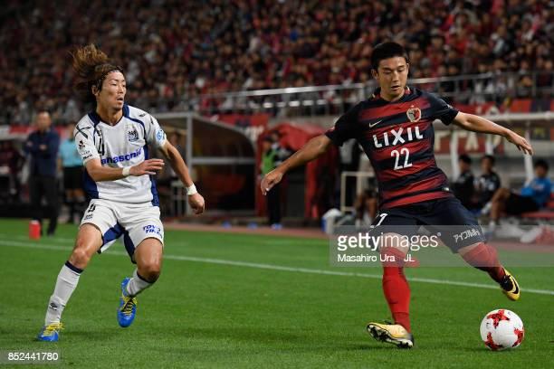 Daigo Nishi of Kashima Antlers and Hiroki Fujiharu of Gamba Osaka compete for the ball during the JLeague J1 match between Kashima Antlers and Gamba...