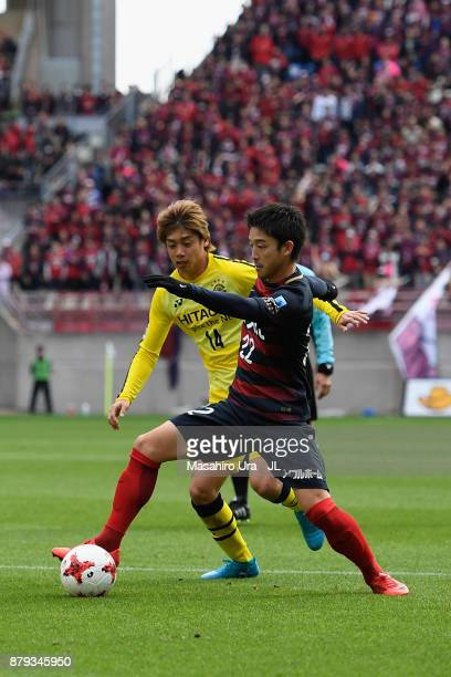 Daigo Nishi of Kashima Antlers and Junya Ito of Kashiwa Reysol compete for the ball during the JLeague J1 match between Kashima Antlers and Kashiwa...