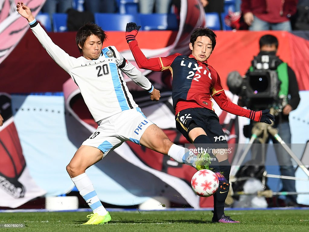 Daigo Nishi of Kashima Antlers (R) and Shintaro Kurumaya of Kawasaki Frontale compete for the ball during the 96th Emperor's Cup final match between Kashima Antlers and Kawasaki Frontale at Suita City Football Stadium on January 1, 2017 in Suita, Osaka, Japan.