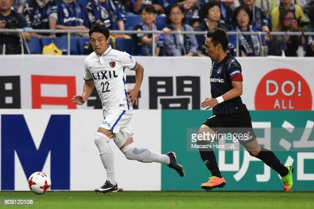 Daigo Nishi of Kashima Antlers and Shu Kurata of Gamba Osaka compete for the ball during the JLeague J1 match between Gamba Osaka and Kashima Antlers...