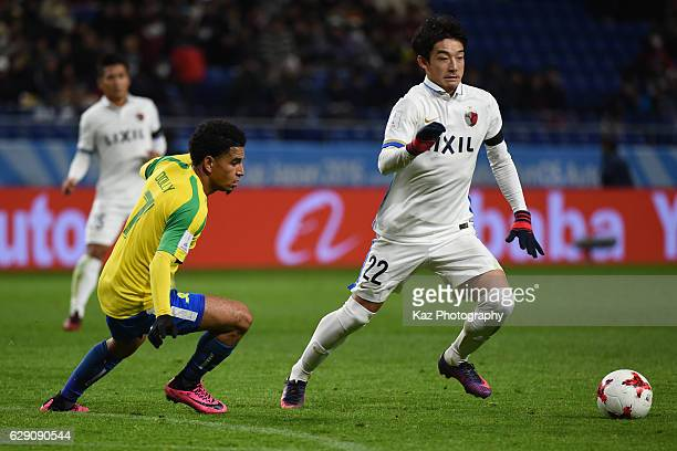 Daigo Nishi of Kashima Antlers keeps the ball under the pressure from Keagan Dolly of Mamelodi Sundowns during the FIFA World Cup Quarter Final match...
