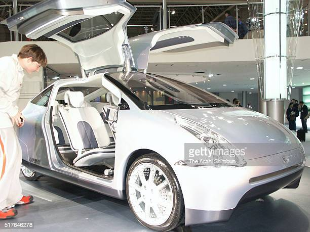 Daihatsu Motor Co's prototype hybrid mini car 'UFE2' is displayed during the 37th Tokyo Motor Show at Makuhari Messe on October 22 2003 in Chiba Japan