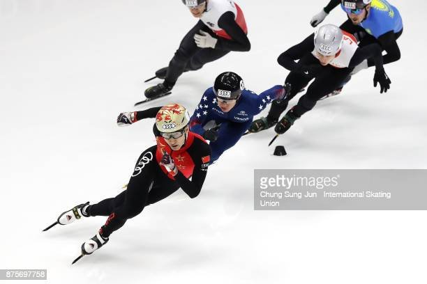 Daijing Wu of China and JR Celski of United States compete in the Men 500m Quarterfinals during the Audi ISU World Cup Short Track Speed Skating at...