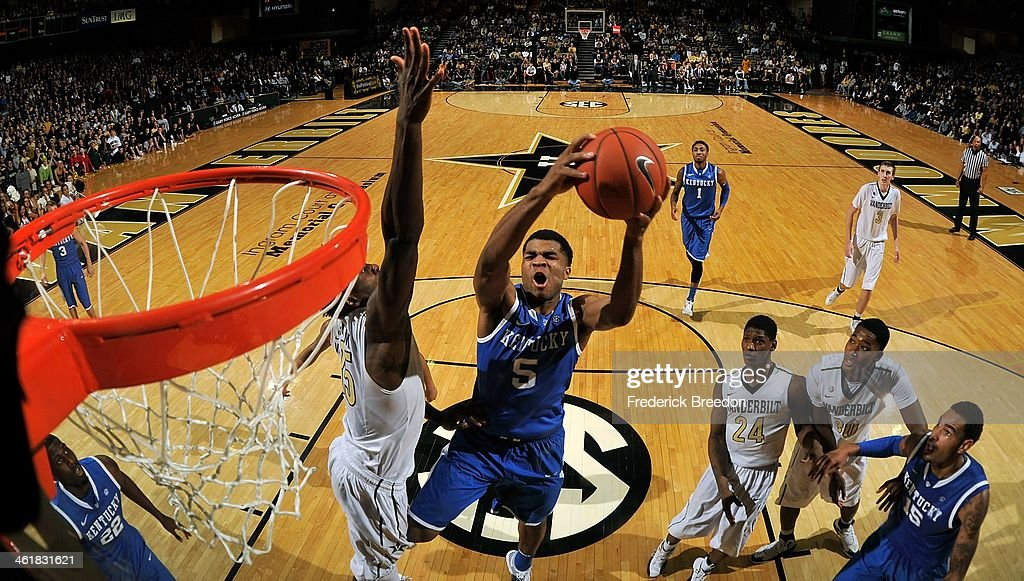 Dai-Jon Parker #24 and Damian Jones #30 of the Vanderbilt Commodores and <a gi-track='captionPersonalityLinkClicked' href=/galleries/search?phrase=Willie+Cauley-Stein&family=editorial&specificpeople=9854040 ng-click='$event.stopPropagation()'>Willie Cauley-Stein</a> #15 of the Kentucky Wildcats watch Andrew Harrison #5 of the Kentucky Wildcats take a shot against the Vanderbilt Commodores at Memorial Gym on January 11, 2014 in Nashville, Tennessee.