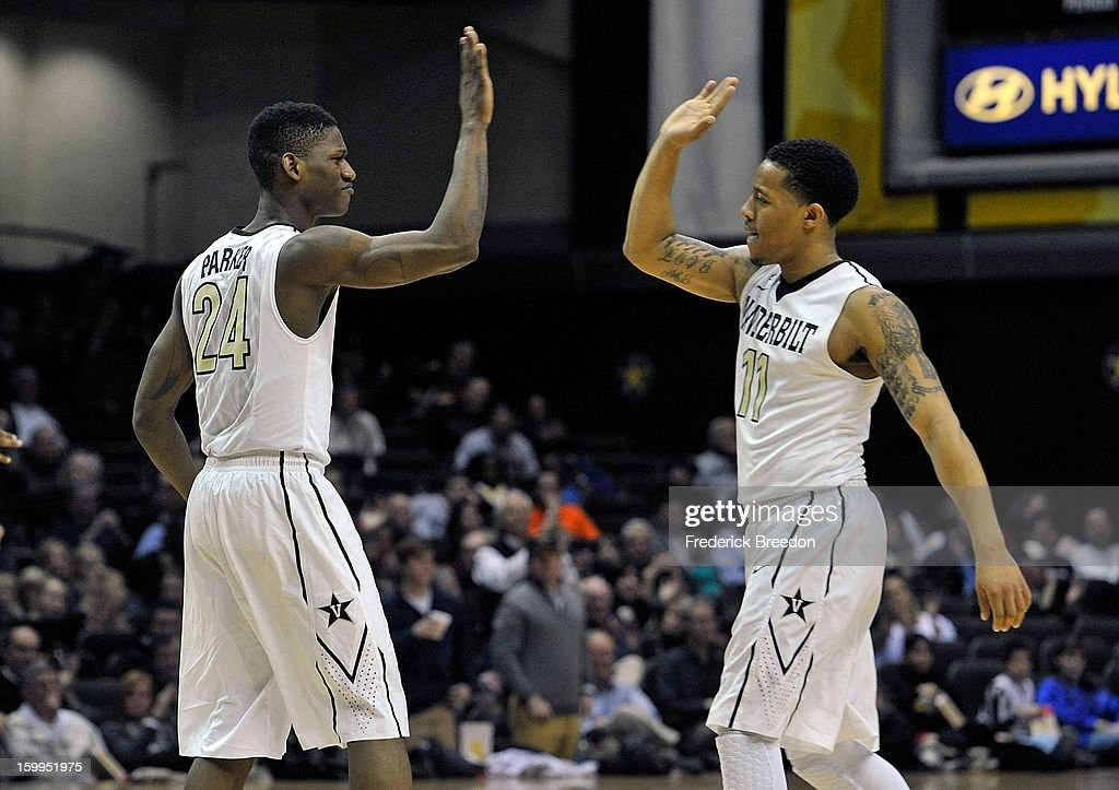 Dai-Jon Parker #24 of the Vanderbilt Commodores high-fives teammate Kyle Fuller #11 during a game against the Auburn Tigers at Memorial Gym on January 23, 2013 in Nashville, Tennessee.