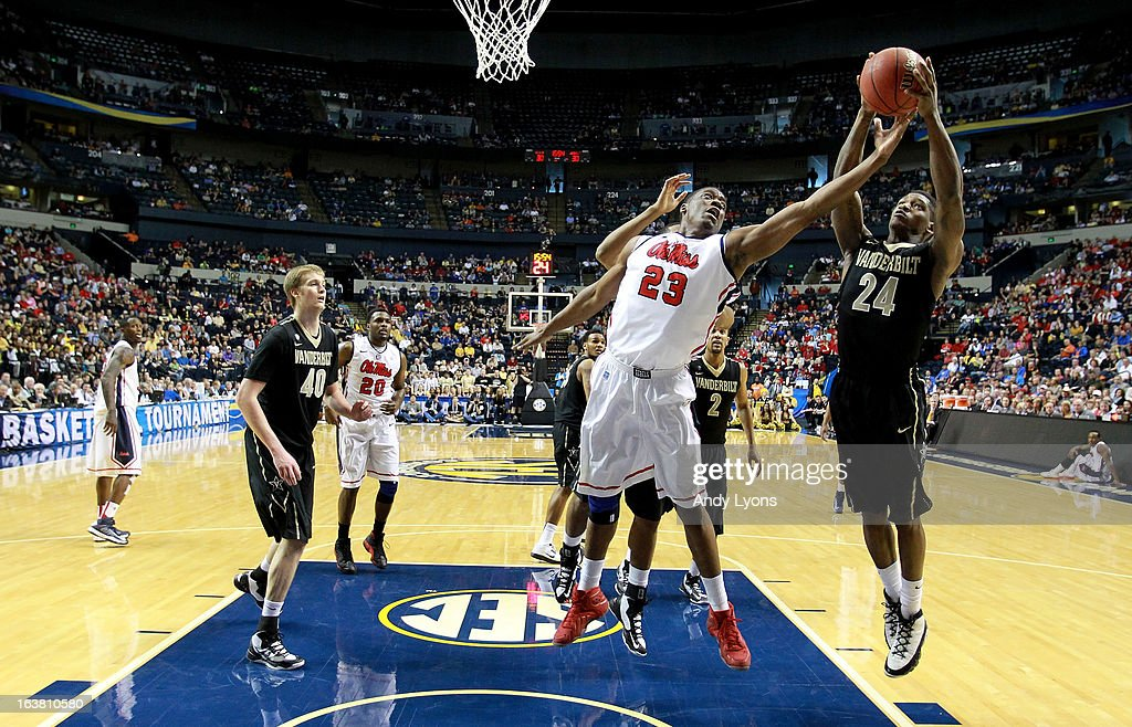 Dai-Jon Parker #24 of the Vanderbilt Commodores rebounds against Reginald Buckner #23 of the Ole Miss Rebels in the second half during the Semifinals of the SEC basketball tournament at Bridgestone Arena on March 16, 2013 in Nashville, Tennessee. Ole Miss won 64-52.