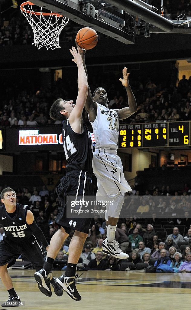 Dai-Jon Parker #24 of the Vanderbilt Commodores takes a shot against <a gi-track='captionPersonalityLinkClicked' href=/galleries/search?phrase=Andrew+Smith+-+Basketball+Player&family=editorial&specificpeople=7641849 ng-click='$event.stopPropagation()'>Andrew Smith</a> #44 of the Butler Bulldogs at Memorial Gym on December 29, 2012 in Nashville, Tennessee.