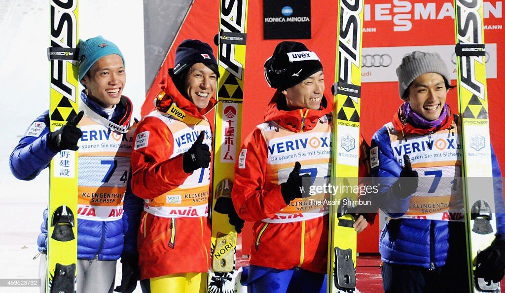 Daiki Ito, Takuk Takeuchi, Noriaki Kasai and Reruhi Shimizu of Japan on the podium after winning silver medals in men's team competition of the FIS Ski Jumping World Cup Klingenthal on November 22, 2014 in Klingenthal, Germany.