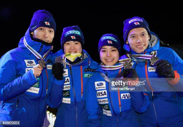 Daiki Ito Yuki Ito Sara Takanashi and Taku Takeuchi of Japan celebrate with their medals during the award ceremony after the Mixed Team HS100 Normal...