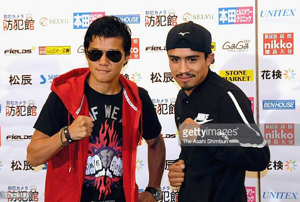 Daiki Kameda of Japan and Rodrigo Guerrero of Mexico pose for photographs at a press conference for their upcoming match on September 1 2013 in...