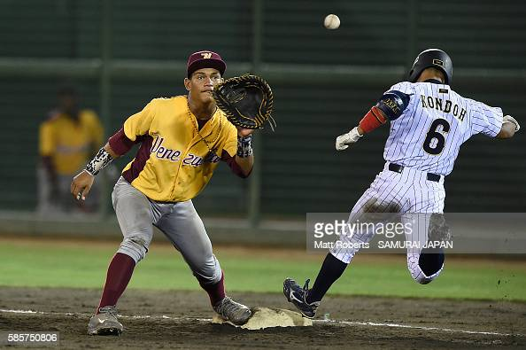 Daiki Kondo of Japan beats the throw to first base after a bunt in the bottom half of the fourth inning in the super round game between Japan and...